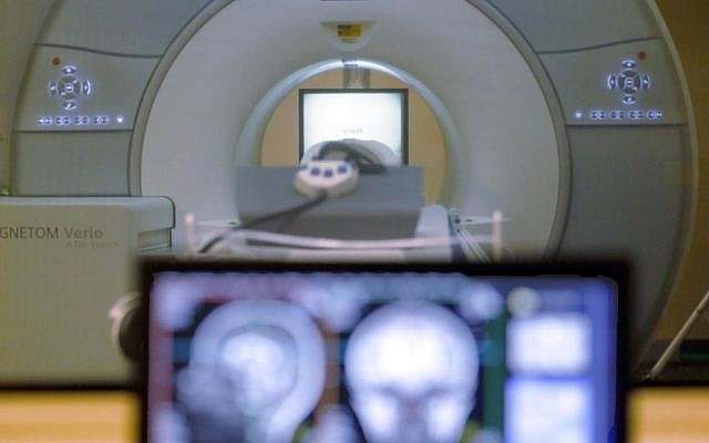 In this Nov. 26, 2014 file photo, the brain-scanning MRI machine that was used at Carnegie Mellon University in Pittsburgh. (AP Photo/Keith Srakocic, File)