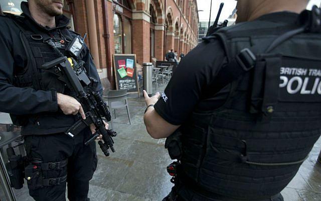 File: British police officers patrol outside St. Pancras international railway station in London, Monday, Dec. 7, 2015. (AP Photo/Matt Dunham)