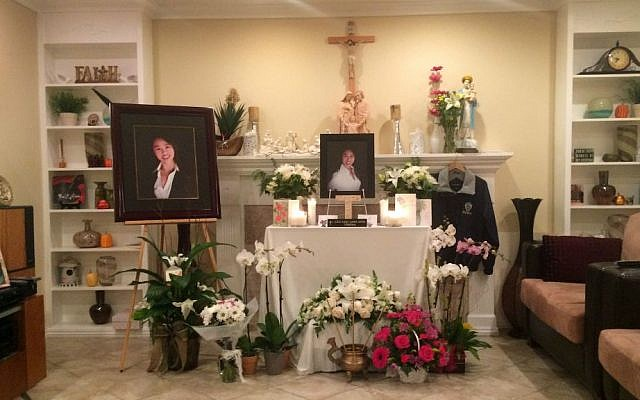 A memorial is displayed in the family home of Tin Nguyen in Anaheim, California, Saturday, Dec. 5, 2015. (AP Photo/Christine Armario)