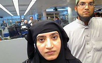 This July 27, 2014 file photo provided by US Customs and Border Protection shows Tashfeen Malik, left, and Syed Farook, as they passed through O'Hare International Airport in Chicago. (US Customs and Border Protection via AP, File)