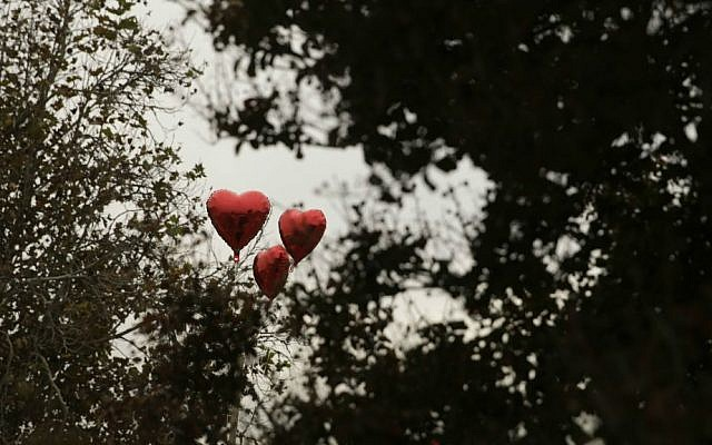 Balloons adorn a makeshift memorial site honoring the victims of Wednesday's shooting rampage, Friday, Dec. 4, 2015, in San Bernardino, California. (AP Photo/Jae C. Hong)