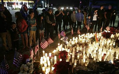 People paying their respects at a makeshift memorial site honoring the shooting victims in San Bernardino, California, December 6, 2015. (AP/Jae C. Hong)