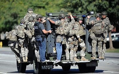 A SWAT vehicle carries police officers near the scene of a shooting in San Bernardino, Calif. on Wednesday, Dec. 2, 2015. (Micah Escamilla/Los Angeles News Group via AP)