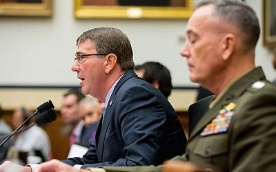 Defense Secretary Ash Carter, left, accompanied by Joint Chiefs Chairman Gen. Joseph Dunford Jr., testifies on Capitol Hill in Washington, Tuesday, Dec. 1, 2015, before the House Armed Services Committee hearing on the US strategy for Syria and Iraq and its implications for the region. (AP Photo/Andrew Harnik)
