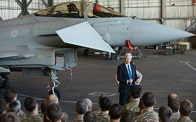 British Defense Minister Michael Fallon talks to British pilots and soldiers at RAF Akrotiri, a British air base near the coastal city of Limassol, Cyprus, Saturday, Dec. 5, 2015. (AP Photo/Pavlos Vrionides)