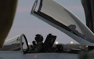 A pilot on a British Typhoon warplane on the ground after landing at the RAF Akrotiri, a British air base near the coastal city of Limassol, Cyprus, Thursday, Dec. 3, 2015. (AP Photo/Pavlos Vrionides)