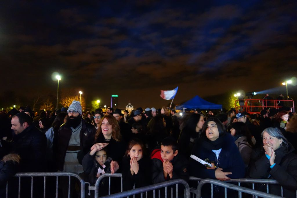 This year's Hanukkah menorah lighting at the Eiffel Tower included heightened security, including a cordoned off area separating the event from the Champ-de-Mars Park. (Greg Scruggs/The Times of Israel)