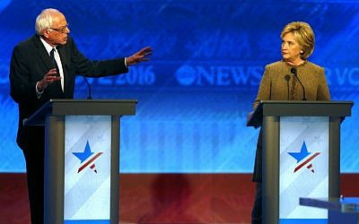 Bernie Sanders, left, alongside Hillary Clinton at the Democratic presidential primary debate Saturday, Dec. 19, 2015, at Saint Anselm College in Manchester, New Hampshire. (AP Photo/Jim Cole)