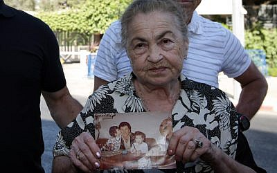 82-year-old Nina Keren, mother of Danny Haran and grandmother of Einat who were killed by Samir Kuntar when he broke into their Nahariya home in 1982 and shot them, holds a picture of her son and her granddaughter on July 15, 2008. ( Kobi Gideon / FLASH90)