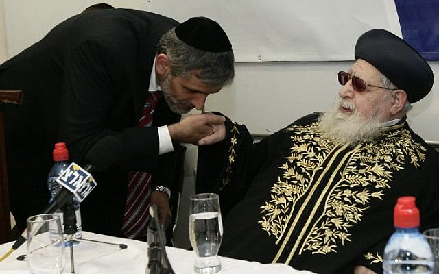 Former Minister of Interior Affairs Eli Yishai Kisses the Spiritual leader of the ultra orthodox Shas party Ovadia Yosef hand during a dedication ceremony for the new home of the Haredi College in Jerusalem on December 14, 2009. (Abir Sultan/Flash 90)