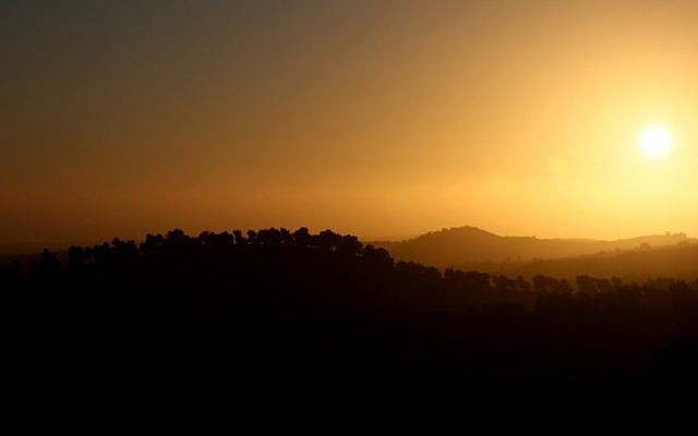 Illustrative image of the sun setting over the Hebron mountains. (Nati Shohat/Flash90, file)