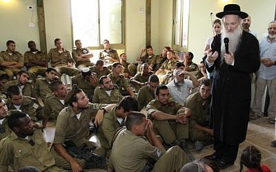 Rabbi Daniel Stavsky speaks to soldiers from the Golani Brigade during a memorial event for the sons of Israeli educator Miriam Peretz, in Gush Etzion in the West Bank on July 8, 2013. (Gershon Elinson/FLASH90)
