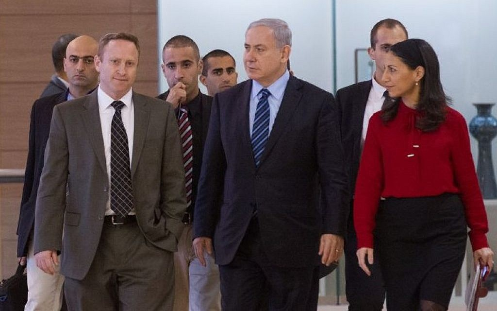 Prime Minister Benjamin Netanyahu flanked by former chief of staff Ari Harow, left, and former parliamentary adviser Perach Lerner, right, as he arrives at a Likud faction meeting in the Israeli parliament, November 24, 2014. (Miriam Alster/Flash90)