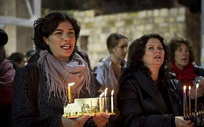 "File: Meretz MKs Tamar Zandberg and Michal Rozin attend a candle lighting ceremony organized by ""Women of the Wall"" on the 3rd night of the Jewish holiday of Hanukkah, at the Western Wall, in Jerusalem's Old City, December 18, 2014. (Danielle Shitrit/Flash90)"