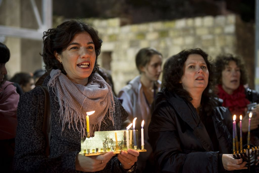File: Meretz MKs Tamar Zandberg and Michal Rozin attend a candle lighting ceremony organized by Women of the Wall on the 3rd night of the Jewish holiday of Hanukkah, at the Western Wall, in Jerusalem's Old City, December 18, 2014. (Danielle Shitrit/Flash90)