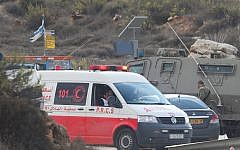 Illustrative: Israeli security forces and a Palestinian Red Crescent ambulance at the Tapuah junction near the West Bank city of Nablus, October 30, 2015. (Flash90)