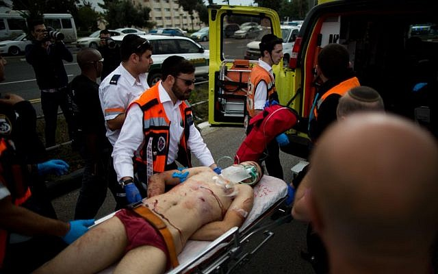 Israeli medics evacuate a Palestinian terrorist after he  stabbed two people in an attack near the Ammunition Hill light rail station in Jerusalem, October 30, 2015. Yonatan Sindel/Flash90)