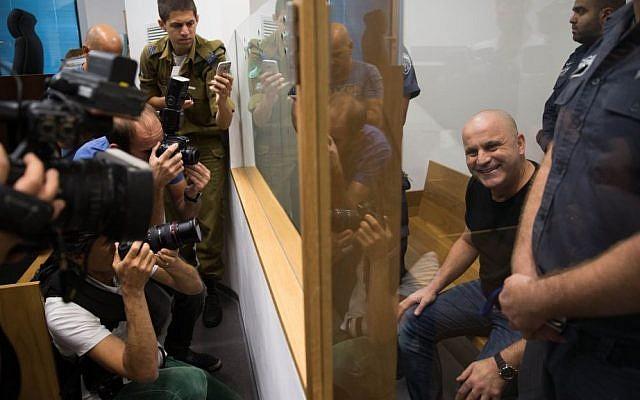 Crime boss Rico Shirazi smiles at photographers at the Tel Aviv District Court on November 02, 2015. (Nati Shohat/Flash90)