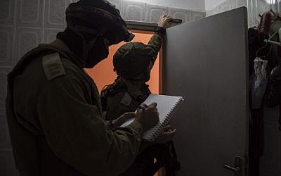 Illustrative. IDF soldiers measure the home of a terrorist in preparation for the building's demolition, on November 28, 2015. (IDF Spokesperson's Unit)