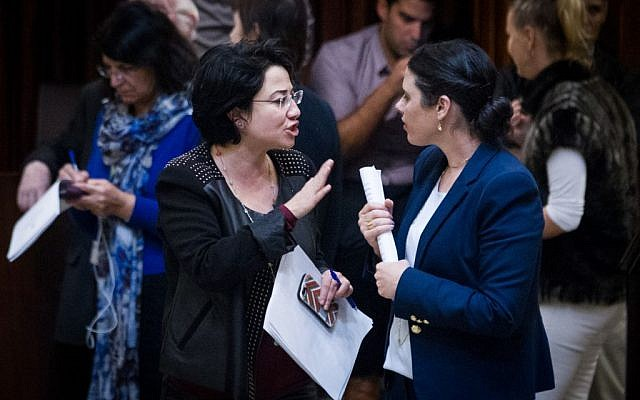 Justice Minister Ayelet Shaked, right, speaks with opposition lawmaker Hanin Zoabi (Joint List) in the Knesset on December 2, 2015. (Miriam Alster/Flash90)