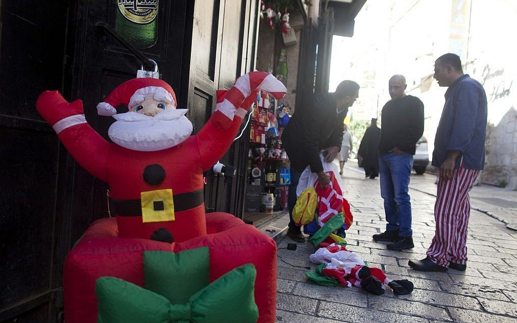 An inflatable Santa Claus at the entrance of a shop in Jerusalem's Old City on December 07, 2015. (Lior Mizrahi/Flash90)