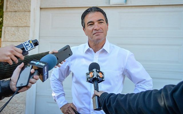 Yossi Cohen, former head of the national security council, leaves his home the morning after Prime Minister Benjamin Netanyahu announced that Cohen will lead the Mossad on December 8, 2015. (Flash90)