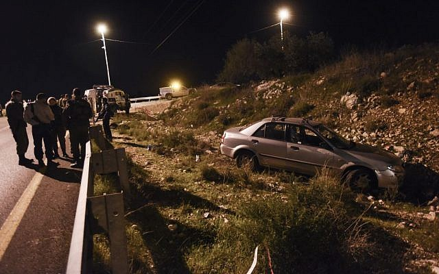 The car which was hit in a shooting terror attack near the West Bank settlement of Avnei Hefez, December 9, 2015. (Photo by Gili Yaari/Flash90)