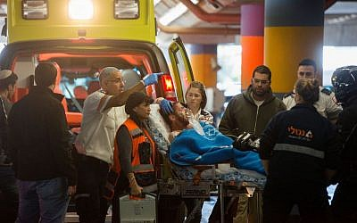 Medics wheel a wounded Israeli soldier into the emergency room of the Shaare Zedek Medical Center after he and another man were stabbed in the West Bank city of Hebron, December 9, 2015. (Photo by Yonatan Sindel/Flash90)