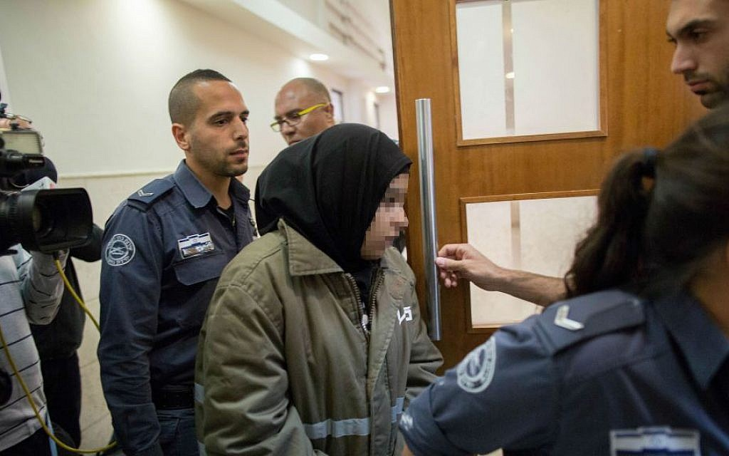 A 16-year-old Palestinian girl arrives at the Jerusalem District Court on December 11, 2015, where she is indicted on two counts of attempted murder for a November 23 stabbing attack in the capital. (Yonatan Sindel/Flash90)