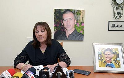 "Zehava Shaul, mother of Oron Shaul, speaks during a press conefrence at her home in Poria Illit, December 13, 2015. Givati Brigade soldier Staff Sergeant Oron Shaul died in battle in the Gaza Strip during Operation Protective Edge in the summer of 2014. The IDF defined him as ""a soldier killed in action whose burial site is unknown."" (Photo by Basel Awidat/Flash90)"