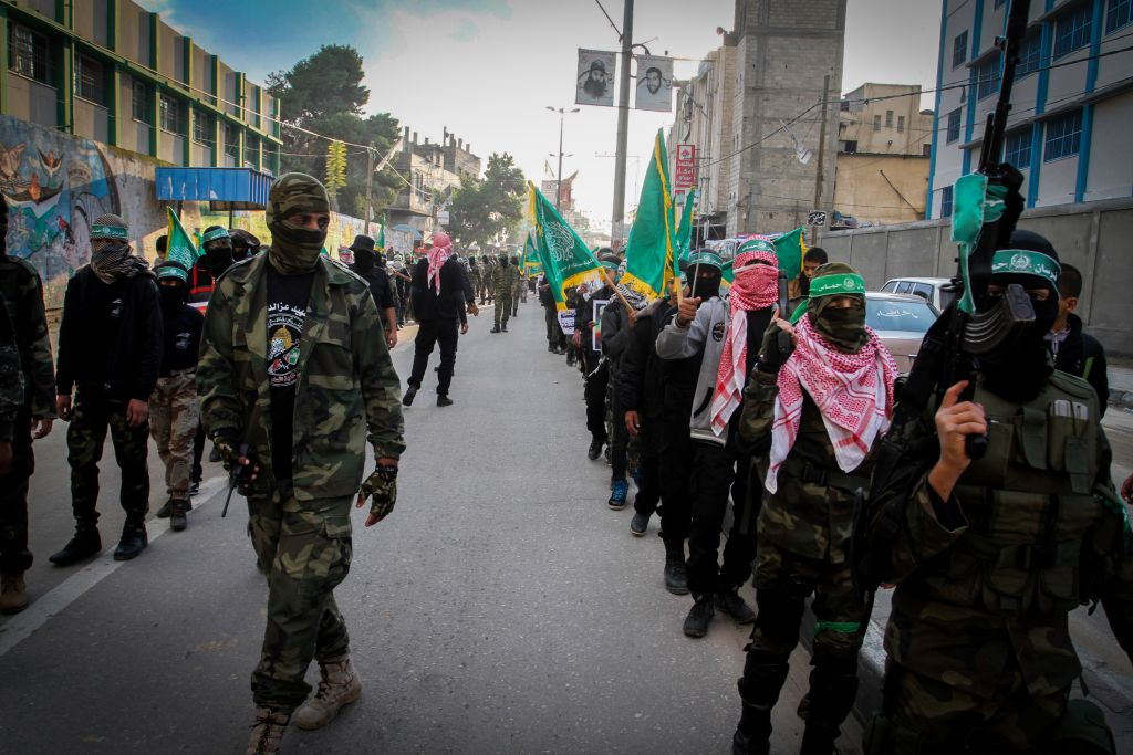 Palestinian youth supporting the Hamas movement take part in a rally marking the 28th anniversary of Hamas' founding, in Rafah, southern Gaza strip December 14, 2015. (Abed Rahim Khatib/FLASH90)