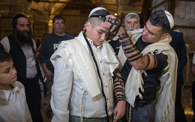 13-year-old Naor Shalev celebrates his bar mitzvah with family and friends at the Western Wall in Jerusalem's Old City, December 17, 2015. (Yonatan Sindel/Flash90)