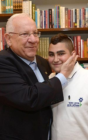 President Reuven Rivlin, left, seen with 13-year-old Naor Shalev Ben Ezra during a special bar mitzvah ceremony at the President's Residence, Jerusalem December 21, 2015. (Mark Neiman/GPO)