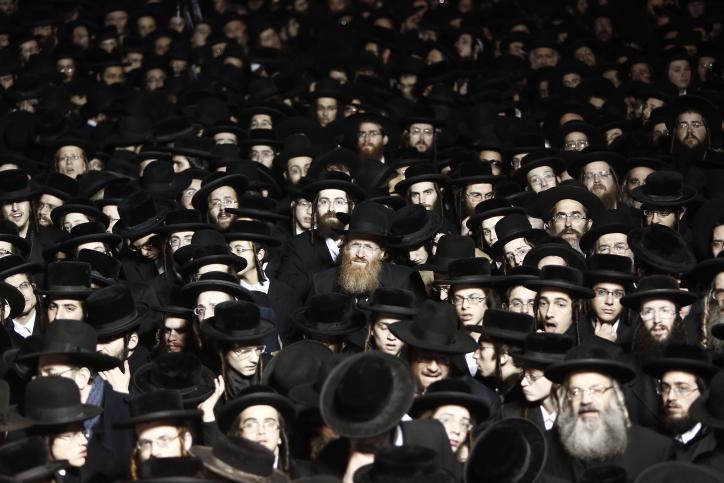 Ultra-orthodox Jewish men protest against the army draft, in Jerusalem's Mea Shearim neighborhood, December 22, 2015. (Yonatan Sindel/Flash90)