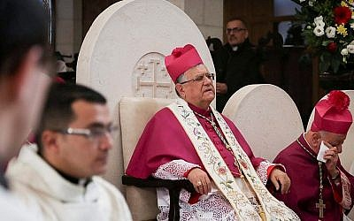 Latin Patriarch of Jerusalem Fouad Twal attends Christmas celebrations in the West Bank town of Bethlehem on Christmas Eve, December 24, 2015. (FLASH90)