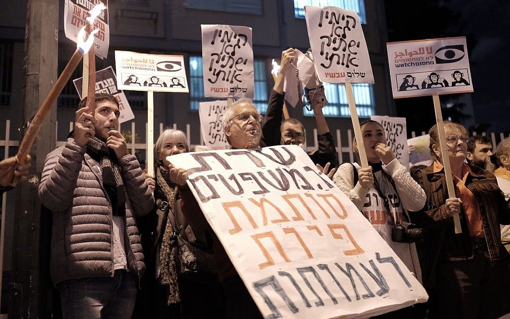 Peace Now activists protest an NGO funding bill proposed by Justice Minister Ayelet Shaked outside her residence in Tel Aviv, December 26, 2015. (Tomer Neuberg/Flash90)