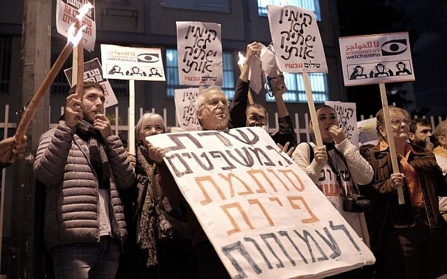 Peace-Now activists protest an NGO bill proposed by Justice Minister Ayelet Shaked outside her residence in Tel Aviv on December 26, 2015. (Tomer Neuberg/FLASH90)