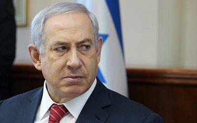 Prime Minister Benjamin Netanyahu speaks during the weekly cabinet meeting in Jerusalem on December 27, 2015. (Marc Israel Sellem/Pool)