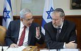 Prime Minister Benjamin Netanyahu speaks with then-cabinet secretary Avichai Mandelblit in Jerusalem on December 27, 2015. (Marc Israel Sellem/POOL)