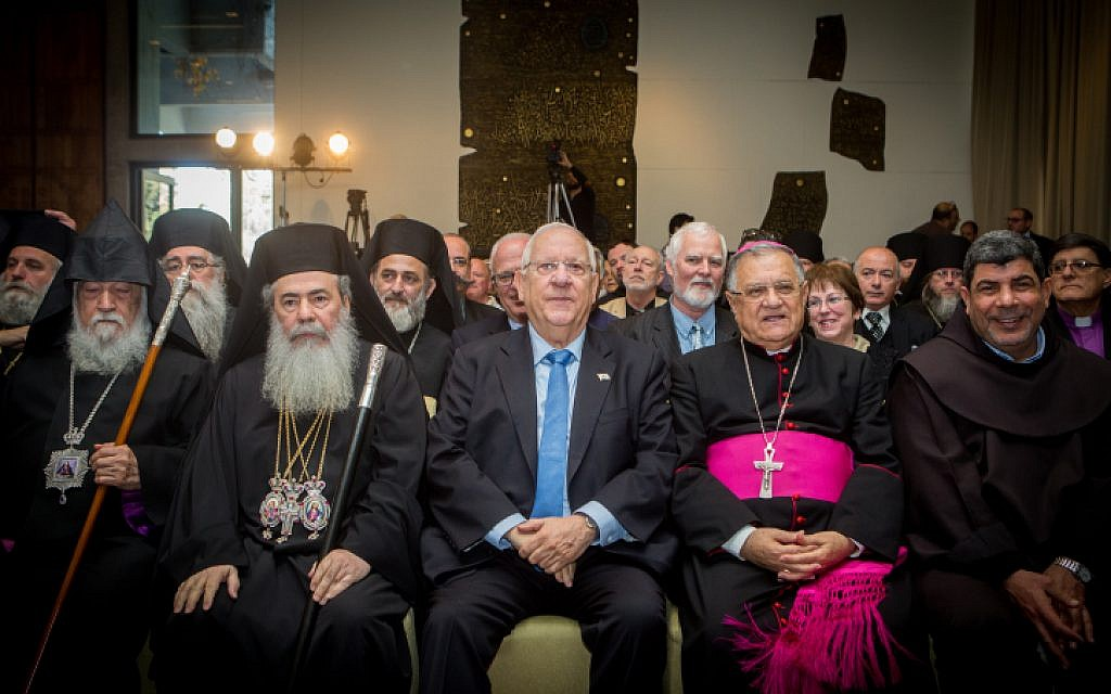 President Reuven Rivlin sits with Latin Patriarch of Jerusalem Fouad Twal and Greek Orthodox Patriarch of Jerusalem Theophilos III at his residence in Jerusalem in honor of the upcoming New Year, on December 28, 2015. (Miriam Alster/FLASH90)