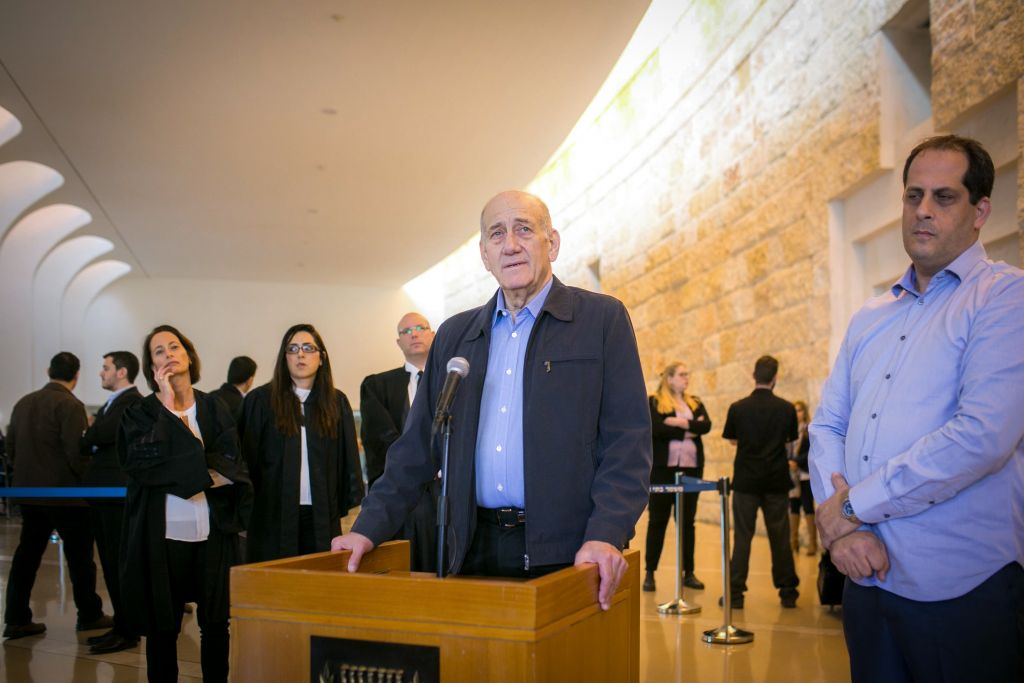 Former prime minister Ehud Olmert speaks to the press at the Jerusalem Supreme Court on December 29, 2015. The court reduced Olmert's sentence to 18 months, following a conviction on corruption charges in the Holyland affair. (Noam Moskowitz/POOL)