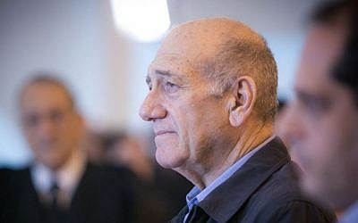 Former prime minister Ehud Olmert speaks to the press at the Supreme Court on December 29, 2015. The court reduced Olmert's sentence to 18 months, following a conviction on corruption charges in the Holyland affair. (Noam Moskowitz/Pool)