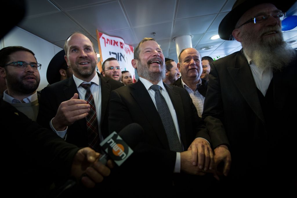 Former Jerusalem Mayor Uri Lupolianski is greeted by supporters as he arrives at his Yad Sarah foundation in Jerusalem, after having a six year jail term reduced to six months community service by the Supreme Court in the Holyland corruption case, December 29, 2015. (Miriam Alster/FLASH90)