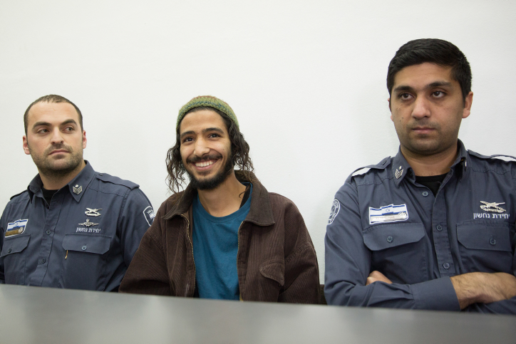 File: Yakir Ashbel (center), the groom from what came to be known as the 'hate wedding' is brought to the Jerusalem Magistrate's Court on December 31, 2015 after being arrested on suspicion of hate and racist incitement at his wedding celebration (Flash90)