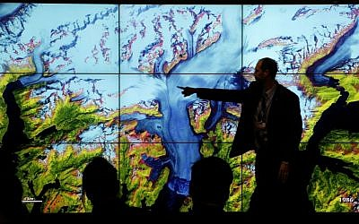 People attend a climate conference at the US pavilion during the COP21, United Nations Climate Change Conference in Le Bourget, north of Paris, Thursday, Dec. 10, 2015. (AP Photo/Christophe Ena)