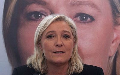 French far-right leader and National Front Party, Marine Le Pen, addresses the media during a news conference, Monday, December 7, 2015, in Lille, northern France. (AP Photo/Michel Spingler)