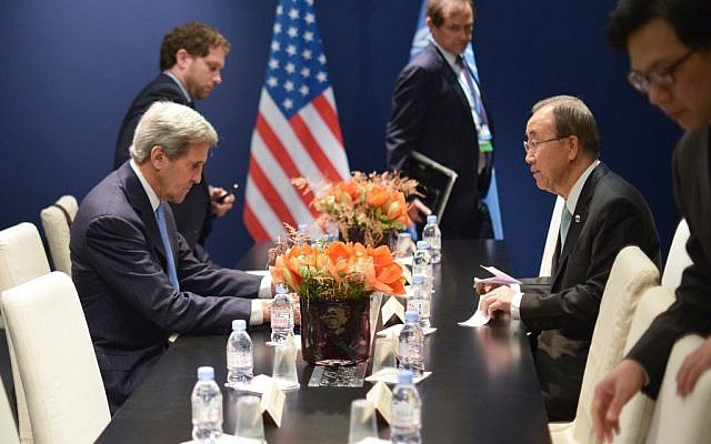 US Secretary of State John Kerry, left, and United Nations Secretary General Ban Ki-moon meet on the sidelines of the United Nations climate change conference, in Le Bourget, on the outskirts of Paris on Friday Dec. 11, 2015. (Mandel Ngan, Pool via AP)