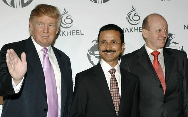 In this Aug. 23, 2008, file photo, Donald Trump, left, His Excellency Sultan Ahmed bin Sulayem of Dubai, center, and then-Nakheel CEO Chris O'Donnell pose together at a party thrown by Nakheel and the Trump Organization to introduce The Trump International Hotel & Tower Dubai. (AP Photo/Chris Pizzello, File)