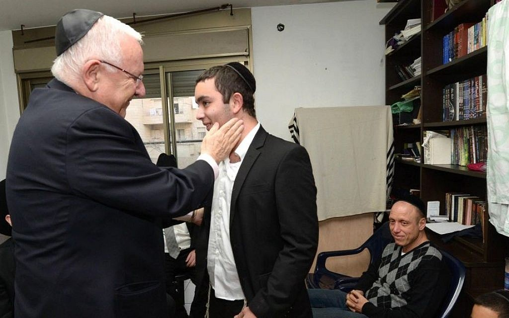 President Reuven Rivlin visits the family of Rabbi Reuven Birmacher, who was murdered in a terror attack in Jerusalem last week, on December 27, 2015. (Mark Neyman/GPO)