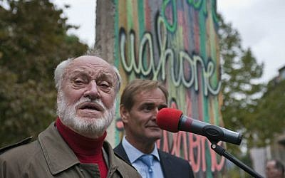 In this Oct. 8, 2009 file photo German conductor Kurt Masur speaks in front of a piece of the former Berlin wall during a ceremony at the Stasi museum in Leipzig, eastern Germany. (AP Photo/Eckehard Schulz, file)